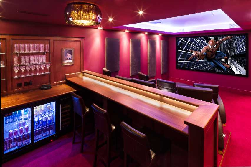 Cinema lighting with pelmet lights and chandelier above bar and seating
